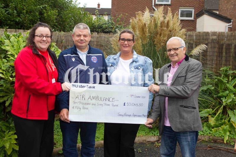 B41-14-10-21-Jimmy-Menagh-cheques-Air-ambulance